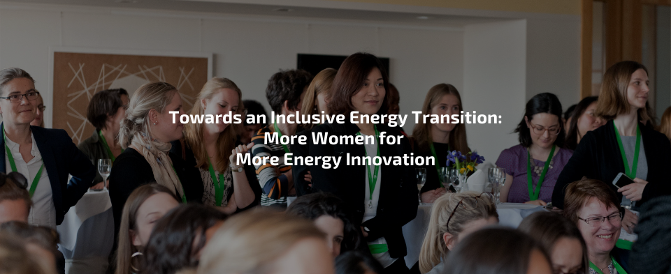 Women in a meeting at the Berlin Energy Transition Dialogue 2018. Some stand and some sit.